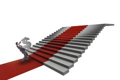 Young businessman climbing stairs and red carpet on white backgr. Ound Stock Photography