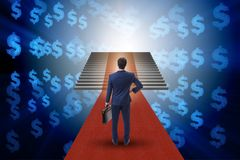 The young businessman climbing stairs and red carpet. Young businessman climbing stairs and red carpet Stock Photo