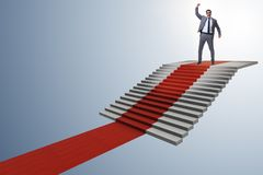 The young businessman climbing stairs and red carpet. Young businessman climbing stairs and red carpet Stock Image