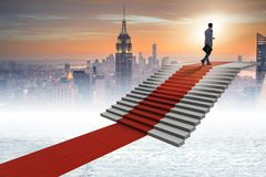 The young businessman climbing stairs and red carpet. Young businessman climbing stairs and red carpet Stock Images