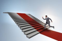 The young businessman climbing stairs and red carpet. Young businessman climbing stairs and red carpet Royalty Free Stock Images