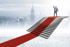 The young businessman climbing stairs and red carpet. Young businessman climbing stairs and red carpet Stock Photography