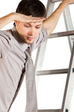 Young Businessman climbink n ladder.Isolated Royalty Free Stock Photos
