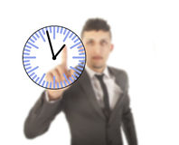 Young businessman with clock isolated Stock Photography