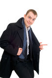 Young businessman in coat walking Stock Image