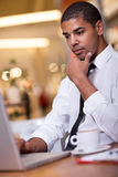 Young businessman in the coffee break working on his laptop Royalty Free Stock Photography