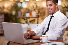 Young businessman in the coffee break working on his laptop Stock Image