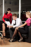 A young businessman with a colleague in the office Stock Images