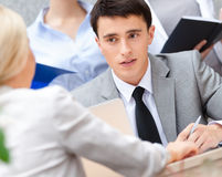 Young businessman with colleagues Royalty Free Stock Image