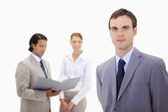 Young businessman with colleagues behind him Royalty Free Stock Image