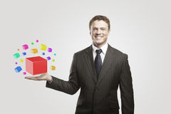 Young  businessman with colored boxes Stock Image