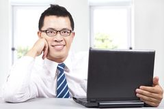 young businessman with computer Stock Photos