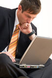 Young businessman with computer Royalty Free Stock Photo
