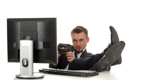 Young businessman with computer and joystick Royalty Free Stock Photo
