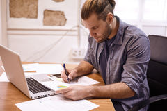 Young businessman concentrating on a chart Stock Photo