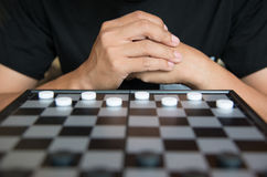Young Businessman Concept Strategic Planning, Man playing checkers game.  stock photo