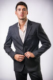 Young businessman confidently posing isolated on Royalty Free Stock Photography