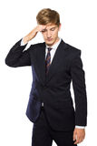 Young businessman confused, feeling stressed, hand in head isola stock images