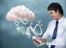 Young businessman connecting to cloud computing Royalty Free Stock Images