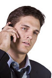 Young businessman conversing on cell phone Stock Photography