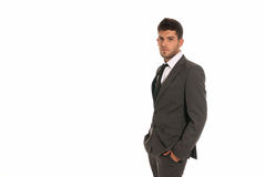 Young businessman copy-space look hands in pocket. Young businessman with copy-space looking serious hands in pockets isolated on white background Stock Image