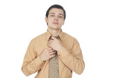 Young businessman corrects tie Stock Photo