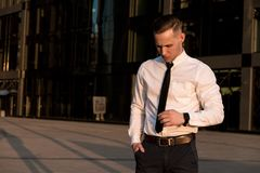 Young businessman corrects a tie stock photo