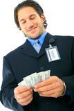 Young Businessman Counting His Money Royalty Free Stock Photos