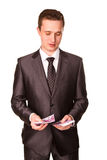 Young businessman counting money Stock Photos