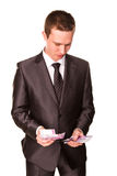 Young businessman counting money Royalty Free Stock Image