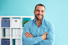 Young businessman with crossed arms Stock Photos