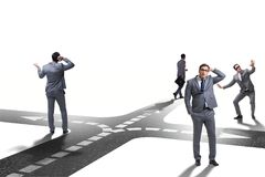 The young businessman at crossroads in uncertainty concept. Young businessman at crossroads in uncertainty concept Stock Image