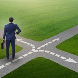 The young businessman at crossroads in uncertainty concept Royalty Free Stock Photos