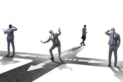 The young businessman at crossroads in uncertainty concept Stock Photography