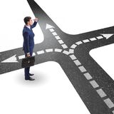 The young businessman at crossroads in uncertainty concept. Young businessman at crossroads in uncertainty concept Stock Photo