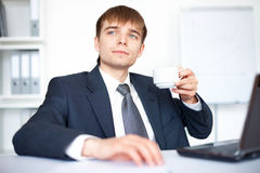 Young businessman with cup of coffee Royalty Free Stock Images