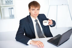 Young businessman with cup of coffee Stock Photos