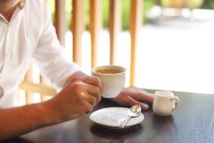 Young businessman with cup of coffee stock image