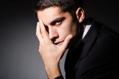 The young businessman in dark studio Stock Photo