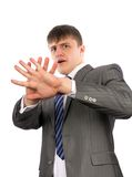 Young businessman defending himself Royalty Free Stock Photo