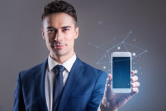 Young businessman is demonstrating display of his phone royalty free stock photography