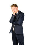 Young businessman in despair clutched his head. Crisis concept Stock Photography