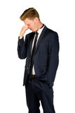 Young businessman in despair clutched his head. Crisis concept Stock Image