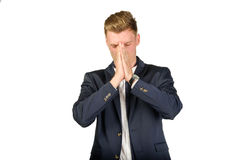 Young businessman in despair clutched his head. Crisis concept Royalty Free Stock Photography
