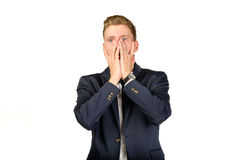 Young businessman in despair clutched his head. Royalty Free Stock Image