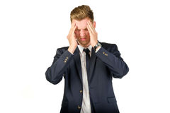 Young businessman in despair clutched his head. Stock Photo
