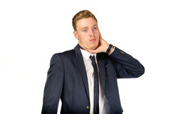 Young businessman in despair clutched his head. Stock Image