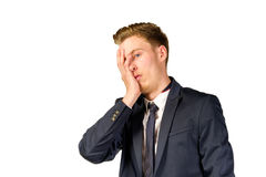 Young businessman in despair clutched his head. Crisis concept Stock Photo