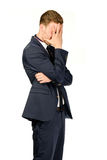 Young businessman in despair covers his face. Royalty Free Stock Photos