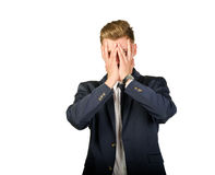 Young businessman in despair covers his face. Royalty Free Stock Photo